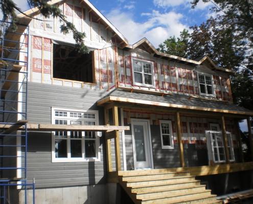 Construction de maison, parement de fibre de bois, revêtement Canexel, FEXA Construction Entrepreneur Général