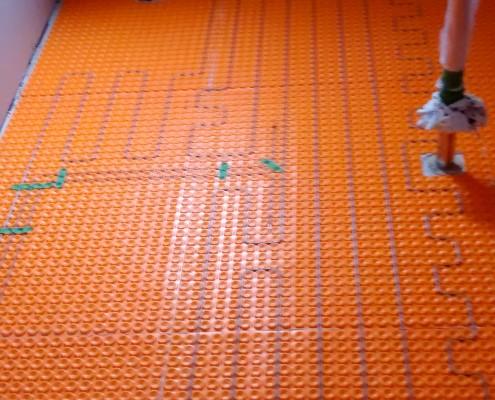 Chauffage radiant, système de plancher chauffant sous la céramique, FEXA rénovation salle de bain