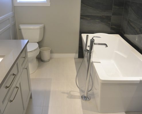 Bain autoportant, robinetterie sur pied, installation céramique, plomberie, FEXA Rénovatin salle de bain